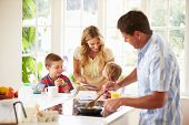foto of scrambled eggs  - Father Preparing Family Breakfast In Kitchen - JPG