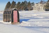 stock photo of shacks  - Rustic ice fishing shack out on the ice - JPG