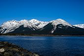 Azure Sky and Snow Capped Mountains Around the Turnagain Arm, Alaska.