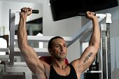 Attractive Man Doing Shoulder Press With Machine