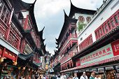 SHANGHAI, CHINA - MAY 30: Chenghuangmiao street with travelers and pagoda style buildings on May 30,