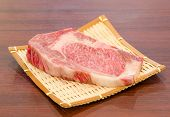 picture of shabu  - Close up Freshness Marbled on Japanese Kobe Matsusaka Beef for BBQ On The Plate in Restaurant King of Beef - JPG