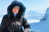 Woman On Winter Mountain Background (austria).