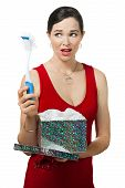 Disappointed Woman Holding Dish Brush Gift.