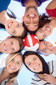 summer, holidays, vacation, happy people concept - group of teenagers with ball looking down