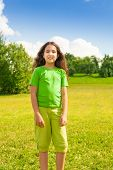 picture of 11 year old  - Beautiful happy smiling girl 11 years old in green shirt standing in the park - JPG