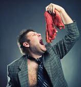 stock photo of pervert  - Crazy businessman with meat - JPG