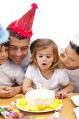 pic of birthday-cake  - smiling family Celebrating Daughter - JPG