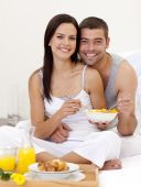 Couple Having Healthy Breakfast In Bed