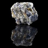 Cordierite with reflection on black surface background