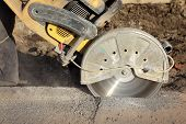 pic of sawing  - Asphalt or concrete cutting with saw blade at construction site - JPG