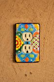 Colorful power outlet plate