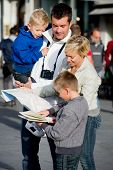 Family looking at map in town