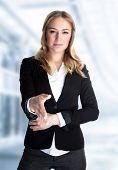 Portrait of cute blond girl stretches out her hand for a handshake, work in great financial company,