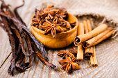 spice anise, cinnamon, vanilla pods on wooden background