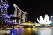 The Helix Bridge, Marina bay sands & Artscience museum at night.