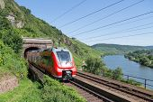 PUNDERICH, GERMANY - JUL 23:  Train leaving a tunnel along the river Moselle near Punderich at July