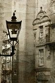 Ancient lantern in Edinburg city, scotland, UK.  Vintage process.