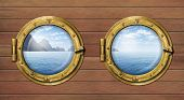 Two ship windows or portholes with sea or ocean with tropical island. Travel and adventure concept.