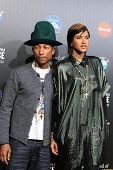 LOS ANGELES - MAR 20: Pharrell Williams, Helen Lasichanh at the 2nd Annual Rebels With A Cause Gala at Paramount Studios on  March 20, 2014 in Los Angeles, California