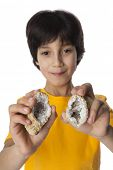 Eight year old boy shows geodes on white background