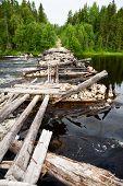 Old demolished bridge in Karelia, Russia