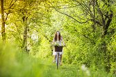 Young woman with bike