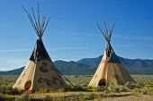 stock photo of tipi  - Painted Indian tipis in northern New Mexico - JPG