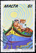 MALTA - CIRCA 1999: A stamp printed in Malta shows picture of two old fat in a boat with colors
