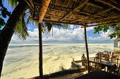 foto of slave-house  - Zanzibar beach and coral rocks bule green ozean Tanzania