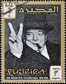 FUJERIA - CIRCA 1965: A stamp printed in Fujeira shows image of sir winston churchil 1874-1965