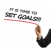 businessman hand with felt tip marker writing text it is time to set goals
