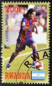 RWANDA - CIRCA 2010: A stamp printed in Rwanda shows showing lionel messi best player football