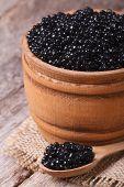 Black Sturgeon Caviar In A Wooden Closeup. Vertical