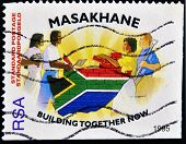stamp printed in South Africa shows people of of different races to build the country's flag