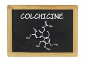 chemical formula of colchicine on a blackboard