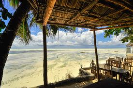 foto of slave-house  - Zanzibar beach and coral rocks bule green ozean Tanzania  - JPG