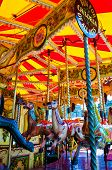 pic of school carnival  - View of Carousel with horses on a carnival Merry Go Round - JPG