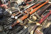 Medieval armor, swords and chainmail, outdoors.