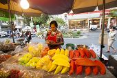 BANGKOK, THAILAND - JANUARY 24: Unknown vendors prepare and sell food on the street on Jan 24, 2014