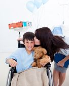 Cheerful Little Boy Sitting On Wheelchair And His Mother