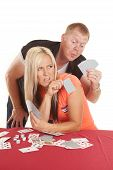 Man Behind Woman Playing Cards Looking