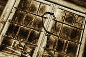 antique keys hanging from old stained glass and leaded window frames, toning idea