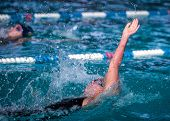 Woman Swimming  Backstroke Race