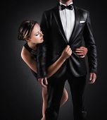 foto of adoration  - Adoration of businessman by a sexy woman - JPG