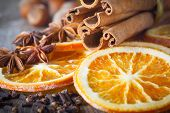 cinnamon sticks, cloves, anise stars, nuts and slices of dried citrus