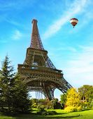 Hugel Eiffel Tower. At the foot of the tower is designed park with paths and pond. In the sky next t
