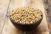 stock photo of soya beans  - Soy beans in a Bowl on wooden table