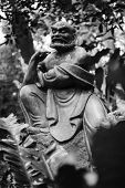 Old ruined Arhat Kanakbharadvaja statue in forest, Taiwan, Asia.