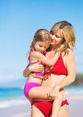 Happy and Loving Mother and Daughter on the Beach, Summer Lifestyle